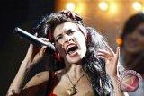 Mantan suami Amy Winehouse koma setelah pesta minuman keras
