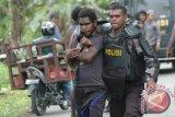 Polisi janji tangkap pembunuh warga di Timika