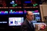Wall Street bervariasi di sejumlah data  ekonomi dan kesaksian Powell