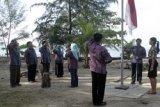 Pengibaran Merah Putih di Pulau Terdepan/Joko Sulistyo