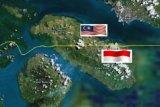 Malaysia turunkan pajak pekerja asing