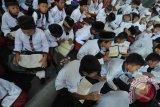 Ribuan pelajar Palembang khataman Al Quran berjamaah