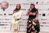 Krisdayanti Rambah Bisnis Pakaian Muslim