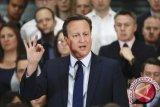 Pengawal mantan PM Inggris lupa menaruh senjata di toilet pesawat