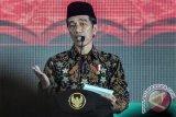Jokowi Janji Tahun Depan Pakai Peci Gus Dur