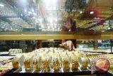 Emas berjangka tertekan meningkatnya pasar saham AS