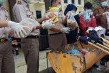 Berpotensi Virus dan Penyakit, Balai Karantina Pekanbaru Musnahkan Barang Impor Asal Malaysia