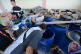 Polisi sita 9.272 botol miras ilegal, 4.000 liter miras Cap Tikus di Palu