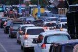 Pasar Tumpah Kuok Bikin Kemacetan, Polisi Arahkan ke Jalan Alternatif Menuju Sumbar