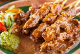 Sate ayam juara dalam sambang griya duta besar Indonesia di Madrid