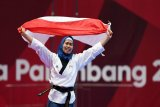 Emas Defia Rosmaniar satu-satunya medali untuk Indonesia cabang Taekwondo