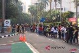 Ratusan orang antre sejak subuh demi tiket final badminton putra