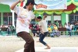 Lestarikan Permainan Tradisional, Mahasiswa Kukerta UNRI Gelar Festival Gasing