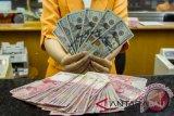 Pergerakan rupiah tertahan karena perkembangan perang dagang AS-China