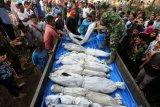 Pemindahan kuburan korban tsunami di Aceh