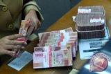 Rupiah menguat seiring sikap longgar Bank Sentral AS