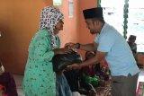 Bersama KNPI Camat Katang Bidare sambangi Pulau Bukit