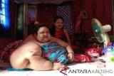 Menurut pakar, ini kronologi obesitas Titi Wati