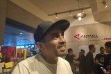 Tunai reaksi unggahan Glenn Fredly soal Prabowo -Sandiaga