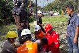 Seorang pekerja tewas tergantung di kabel tower Sutet Pulang Pisau