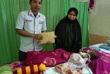 Perum LKBN Antara Sulteng dan Pantang Minta serahkan bantuan untuk Ibrahim