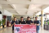 Smartfren Serahkan Reward Smart Koin kepada Mitra Outlet di Padang
