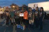 Binmas Noken Polri berikan bantuan korban banjir bandang Sentani
