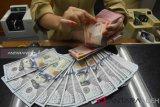 Nilai Rupiah ditutup menguat seiring kembalinya optimisme pasar