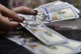 Dolar melemah karena kekhawatiran pertumbuhan global berkurang