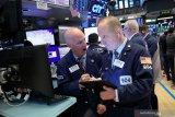 Wall Street melemah di tengah laporan laba emiten