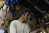 These two men make coconut as an attractive craft