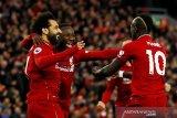 Liverpool libas Huddersfield dan puncaki klasemen lagi