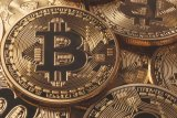 Bitcoin di atas 7.000 dolar setelah capai tertinggi 9-bulan