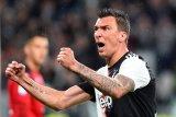 Mario Mandzukic dan Can tidak masuk skuat Juve untuk Liga Champions