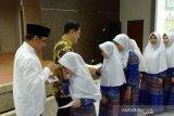 KPPU Kanwil VI Makassar beri bantuan dan buka puasa bersama anak yatim