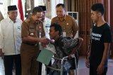 Baznas Pati serahkan bantuan kepada 116 penyandang disabilitas
