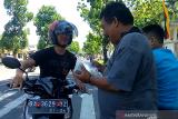 Penukaran pecahan uang di pinggir jalan Padang capai Rp21 juta sehari