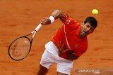 Tidak ada lapangan rumput di Serbia? Tak masalah bagi Djokovic