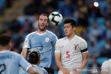 Penyisihan Grup C, Jepang tahan imbang Uruguay 2-2