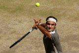 Federer tolak ide pelatih memberi instruksi di lapangan