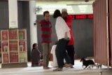Wanita bawa anjing ke masjid ditetapkan sebagai tersangka
