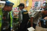 Polisi menggelar razia miras di sejumlah warung Minahasa Utara