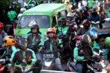 Grab bantah mitra pengemudi kesulitan tarik dana