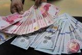 Rupiah ditutup melemah namun tak lewati Rp14.000