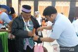 Seorang calhaj Papua belum bisa berangkat ke Tanah Suci