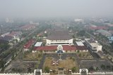 Pindah ibu kota, keluar dari gempa ke asap pekat kebakaran hutan