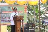 Bupati Wardan resmikan program BSPS di Desa Teluk Kiambang, Tempuling