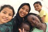 Keceriaan anak-anak pencari suaka di tempat penampungan
