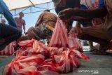 Pembagian daging kurban untuk bencana alam