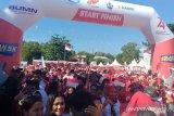 Tim BUMN Hadir Untuk Negeri ajak masyarakat Kota Manado jalan sehat 5K